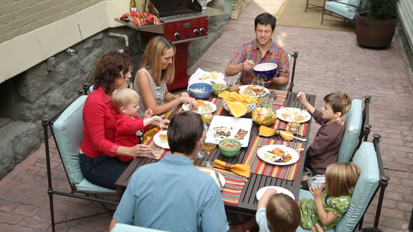 Portrait of family eating on patio