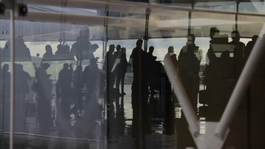 Passengers at airport waiting lounge