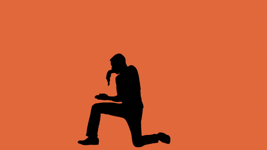 A male dancer silhouette on an orange background