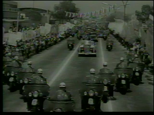 Mexicans welcome a cortege with French President Charles De Gaulle and Mexican President Adolfo Mateos,Mexico City, Mexico circa 1964-MGM PICTURES, UNIVERSAL-INTERNATIONAL NEWSREEL,USA, filmed in 1964 - SD stock footage clip