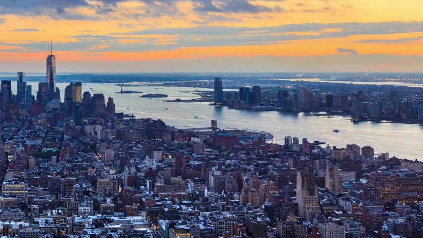 New York City Manhattan aerial skyline. Pan across cityscape panorama. Transition from sunset to night. Timelapse. | Shutterstock HD Video #4801376