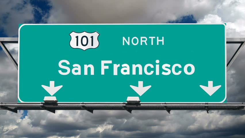 San Francisco 101 fwy sign with time lapse clouds.