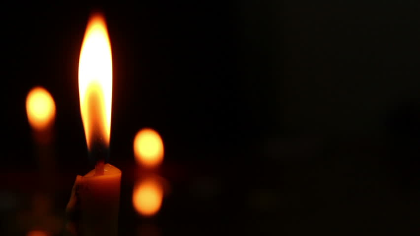 Dolly shot of Candlelight in the dark