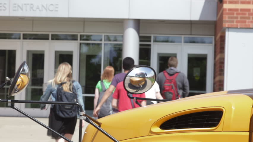High school kids getting off a bus and walking to school   Shutterstock HD Video #4813220