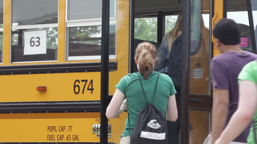 High school kids getting on a school bus  | Shutterstock HD Video #4825181