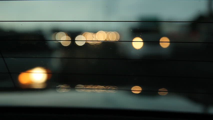 View through rear car window. View through rear of car window.  Driving on the 401 highway in Toronto, Ontario, Canada.
