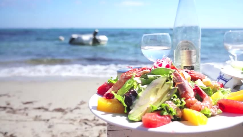 Beautiful lunch on a white sand beach - HD stock video clip
