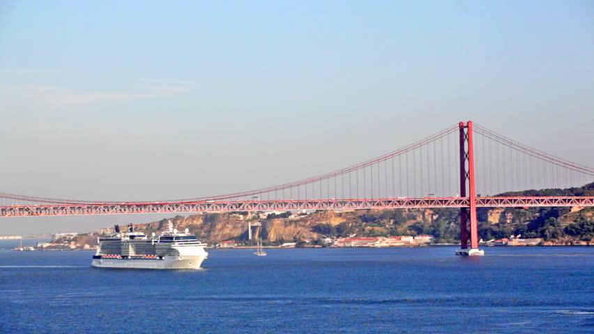 big ship floats under the bridge on April 25 in Lisbon, Portugal #4868642