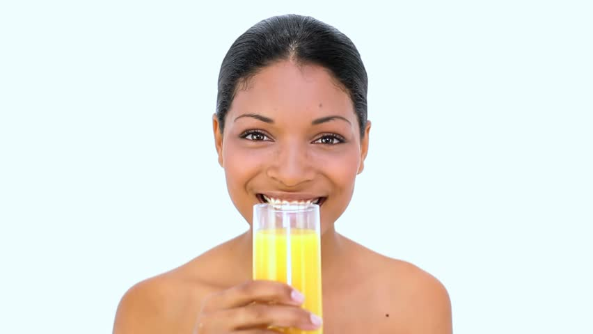 Beautiful woman drinking orange juice on white background - HD stock footage clip