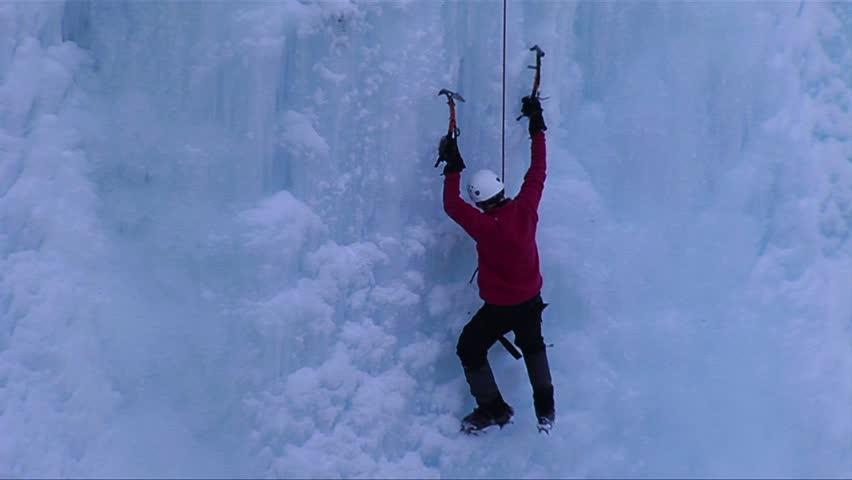ONTARIO, CANADA-CIRCA 2012-A man climbing a frozen waterfall. - HD stock footage clip