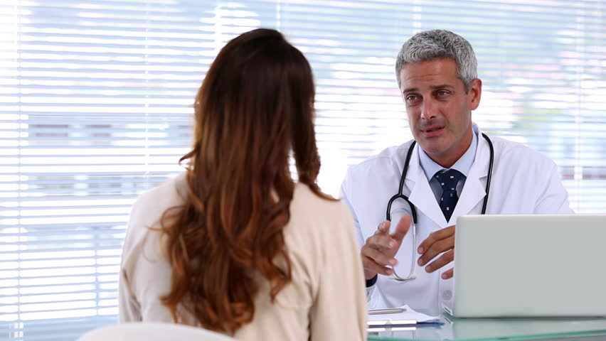 Doctor discussing with a patient in his office