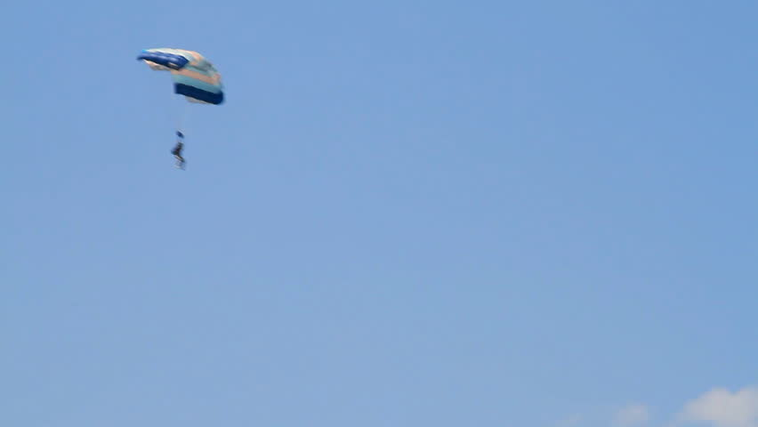 landing of parachutists against the clear sky