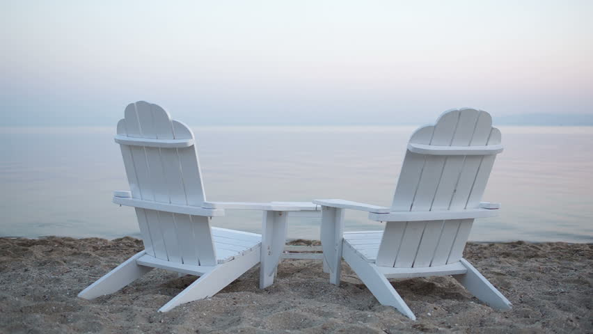 White Wooden Beach Chair Empty white painted wooden deck chairs on a ...