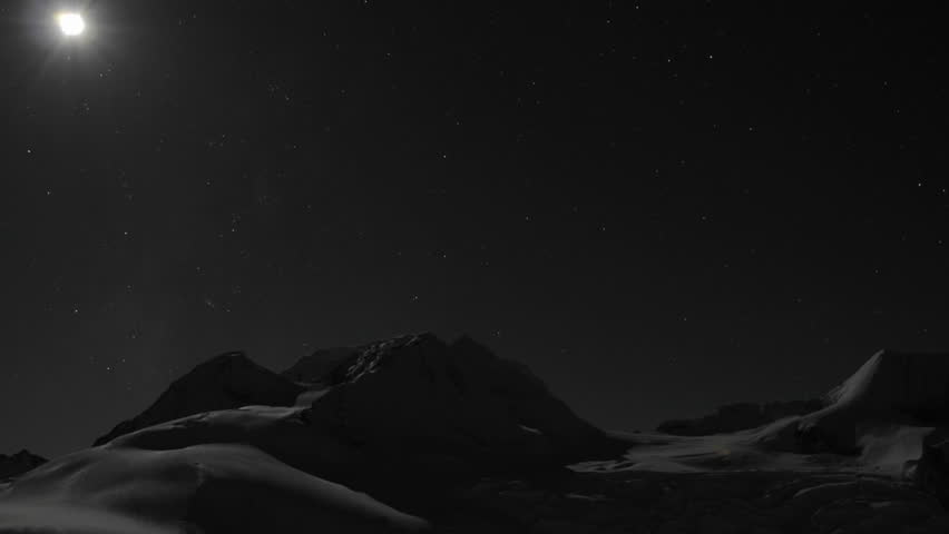 Moon setting behind mountain. - HD stock footage clip