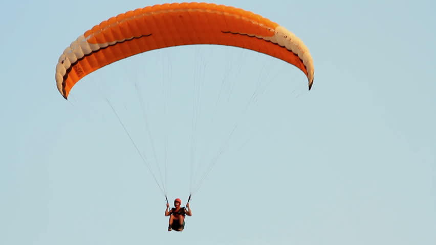 Paragliding over the mountains against clear blue sky | Shutterstock HD Video #4891304