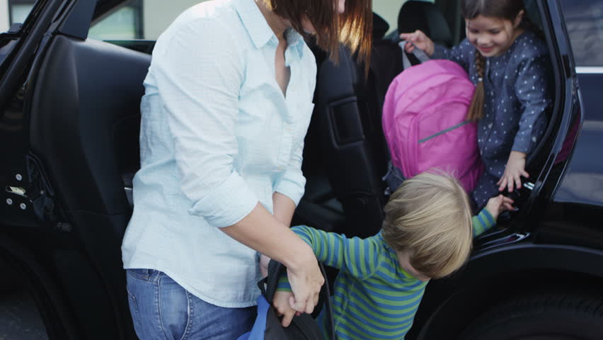 Mom bringing kids to school | Shutterstock HD Video #4898261