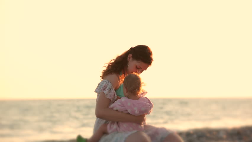 Breastfeeding on beach