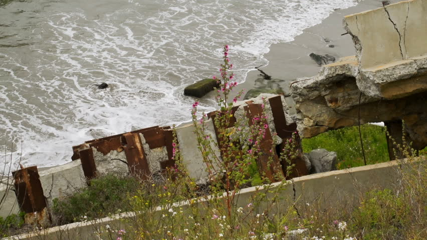 Close up on building debris after a storm surge - HD stock footage clip