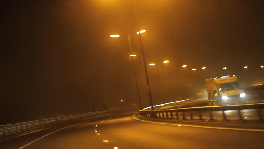 Car Driving Down Highway during Foggy Night - POV Point of View  | Shutterstock HD Video #4972664
