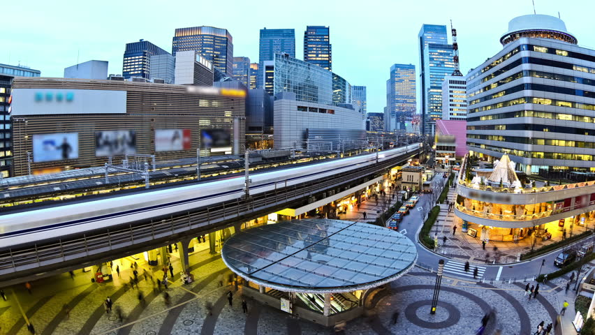 City traffic time lapse of Ginza train station.