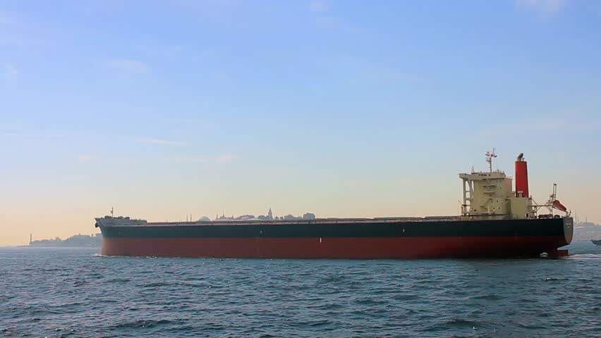 Tanker ship on route to open sea. Side view of the crude oil tanker. High