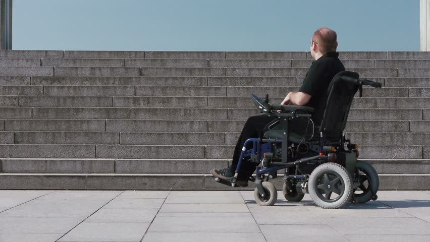 Disabled Person In A Wheelchair On Top Of An Inaccessible