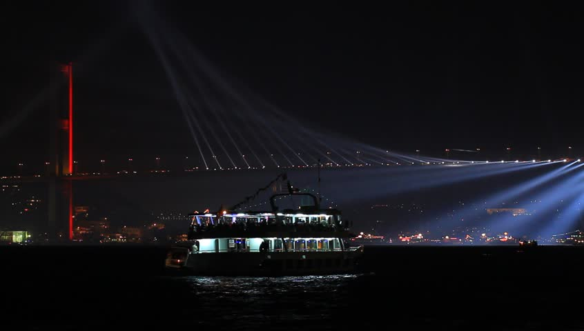 Light beams over the Bridge. Istanbul celebrates to Anniversary of Republic with