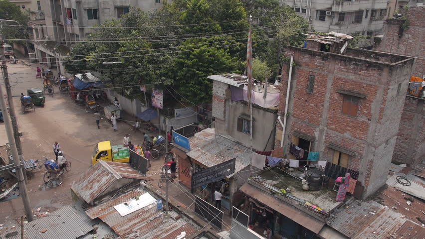 One of the larger refugee camps in Dhaka. This is a scene taken from high up and shows a busy intersection. - HD stock video clip