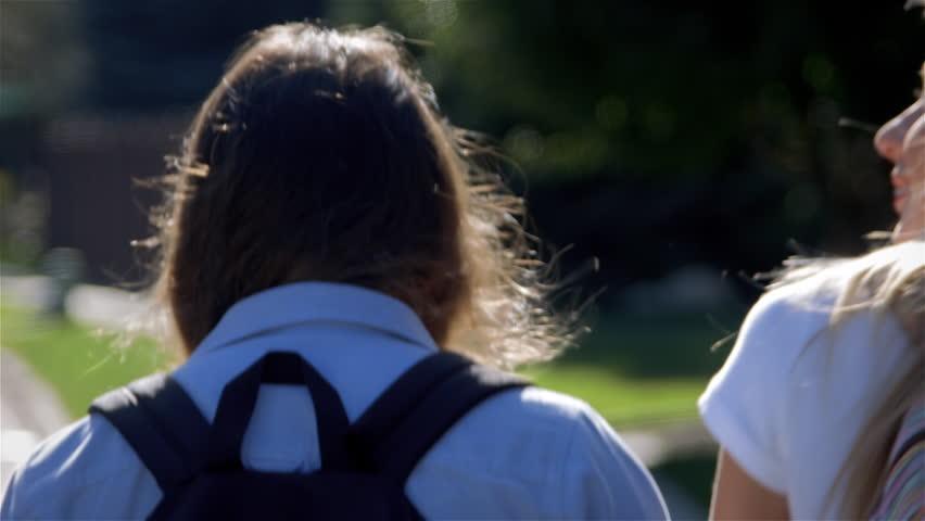 Three Teenage Girls Talking & Walking (Away) In School Uniforms