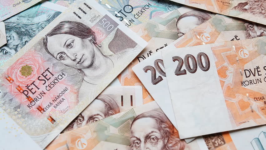 Panning Shot of The Czech Koruna or Czech Crown Money With Different Denominations of Banknote Currency From The Czech Republic.