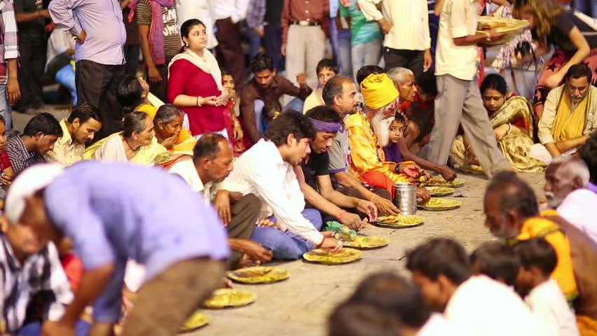 VARANASI, INDIA - MAY 2013: Poor Indian People Eating Free ...