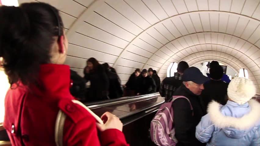 UKRAINE, KIEV, MARCH 12, 2009: People on escalator to underground station in Kiev, Ukraine, March 12, 2009 - HD stock footage clip