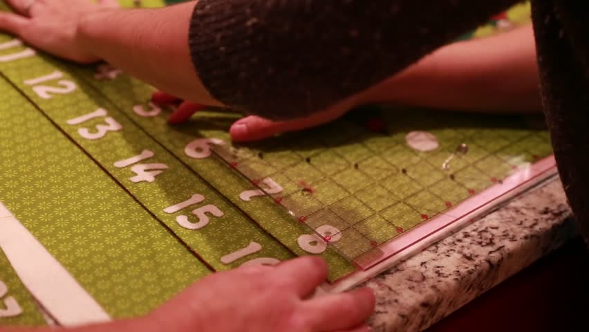 A woman sewing a christmas advent calendar - HD stock video clip