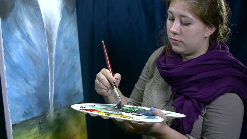 Woman artist with big palette drawing spinning tornado on canvas - HD stock footage clip