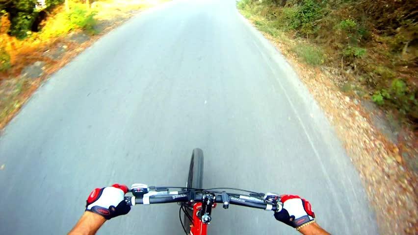 HD: Downhill on mountain bike - Stock Video. View from mountain bike at high speed on downhill asphalt road.
