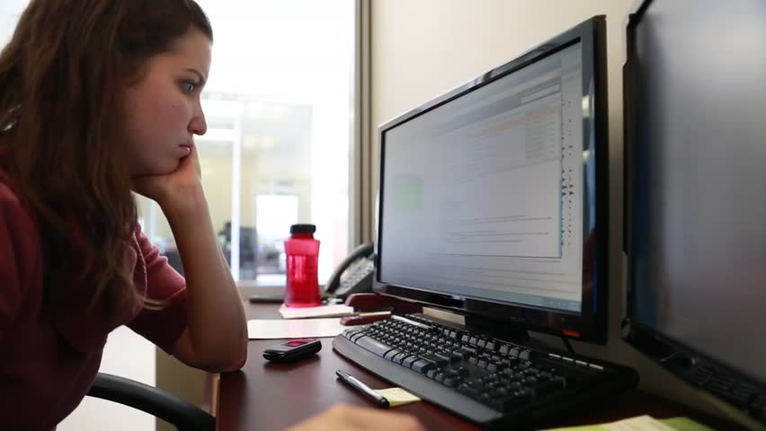 A woman geologist working at the office on her computer