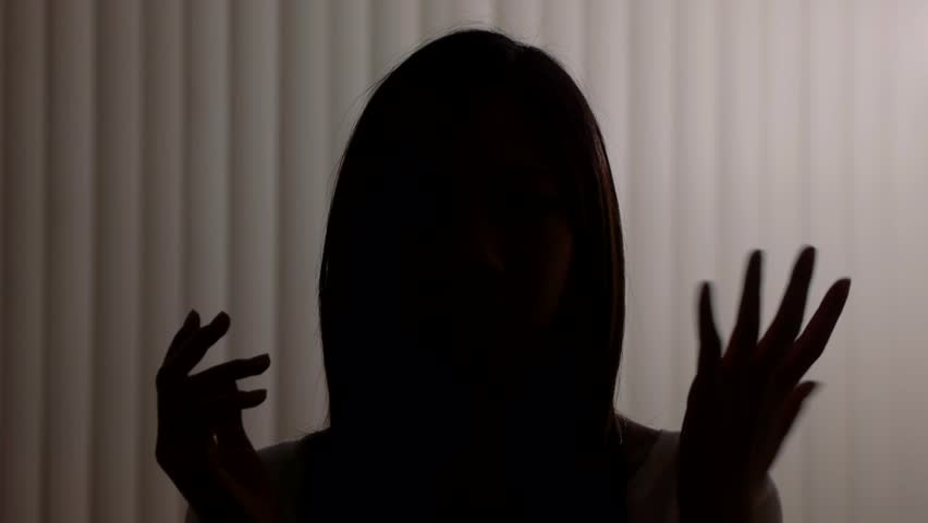 silhouette of a young girl explaining