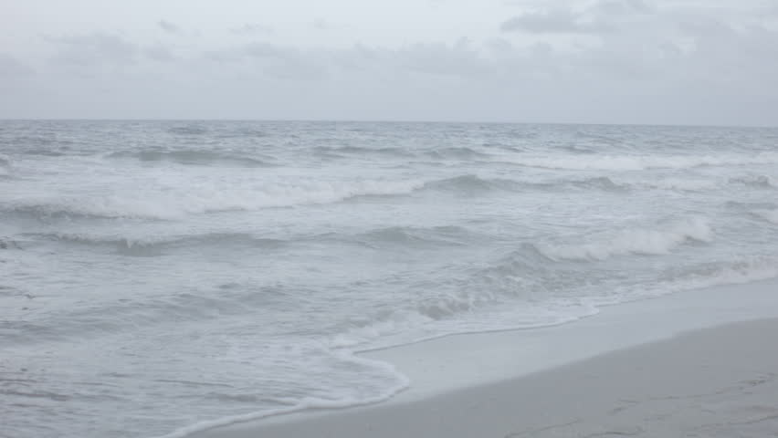 a shot of the ocean waves rolling on shore in fort lauderdale fl - HD stock video clip