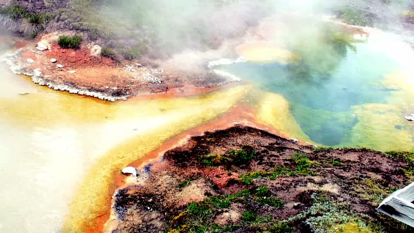 panning colorful spring with vapors at Yellowstone - HD stock footage clip