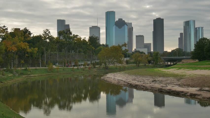 Houston, Texas - November 20, 2013 - Pan from downtown Houston skyline to the pedestrian bridge over Buffalo Bayou.