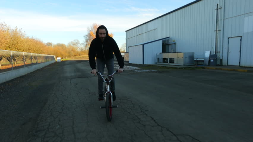 Man riding bicycle - HD stock video clip