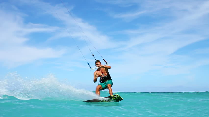 Young Man Kitesurfing in Ocean, Extreme summer sport hd, Slow motion  | Shutterstock HD Video #5197214