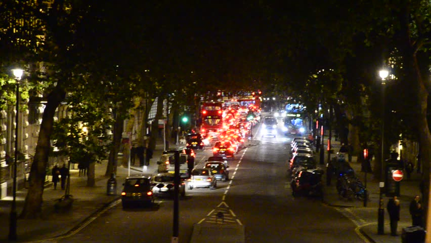 Night traffic jam drives down towards Tower of London and Tower Bridge in