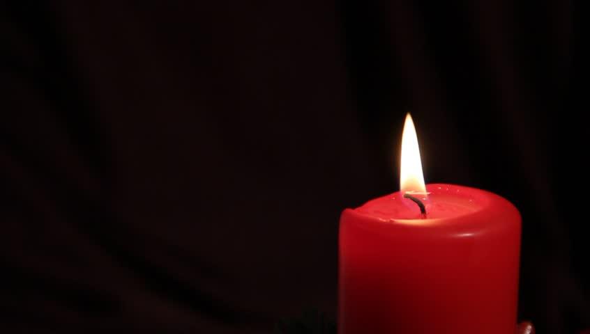 Seamless Loop Three Red Candles Burning On Black ...