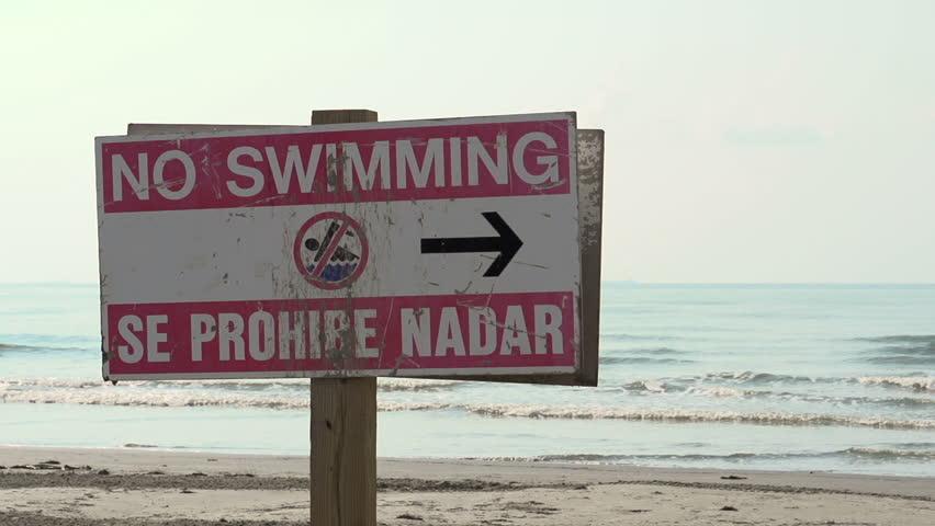 No swimming sign at ocean shore - HD stock footage clip