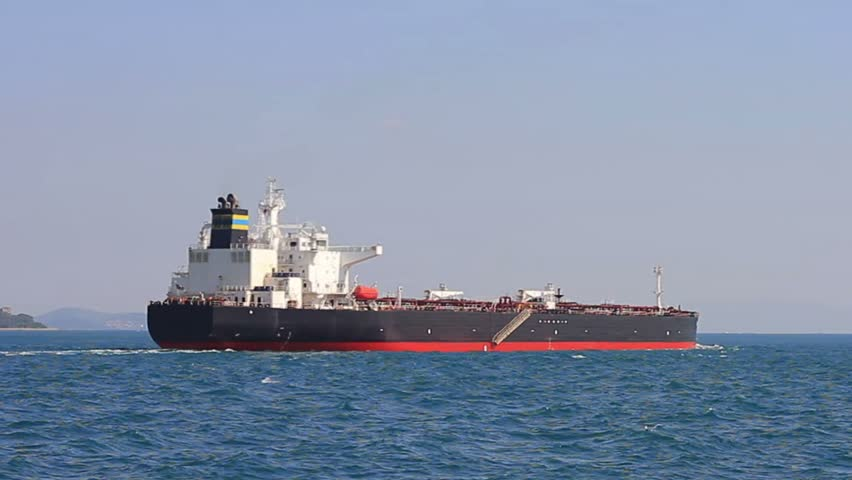 Cargo ship sailing into open sea. Oil tanker ship on route to Marmara Sea. Back