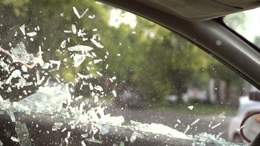 Breaking driver side car window slow motion