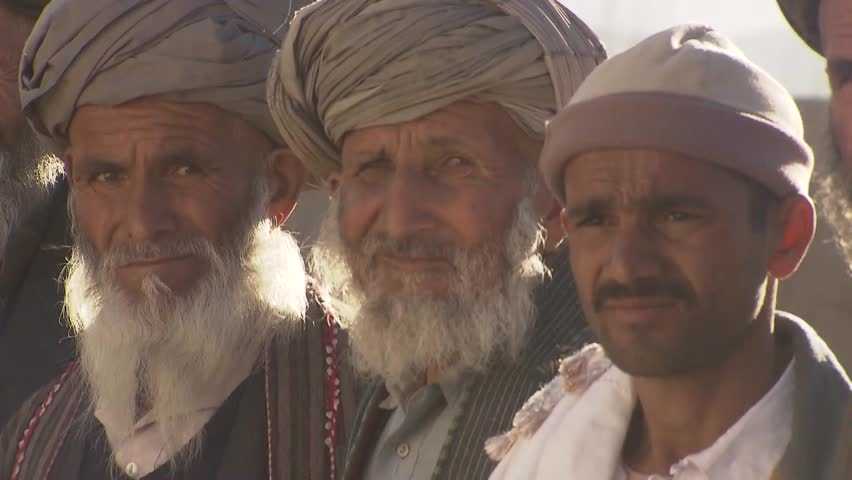 TALOQAN/AFGHANISTAN - OCTOBER 14 2013:  Village Elders, teachers and students attend opening of new school building in a remote area of Taloqan province in northern Afghanistan.   - HD stock video clip