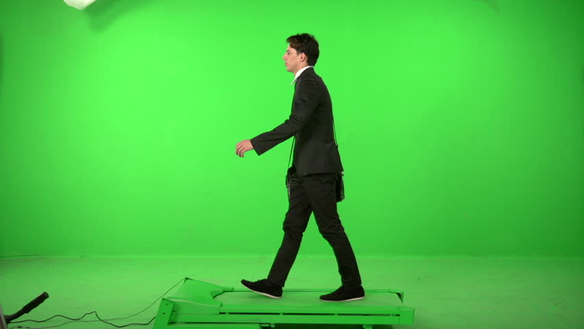 Business man walking on a green screen backround | Shutterstock HD Video #5226230