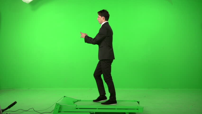 Business man walking on a green screen backround | Shutterstock HD Video #5226257